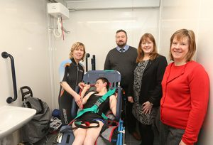 photo of managers and person with disabilities in the changing places toilet at Cupar leisure centre